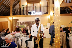 Saxophonist entertaining guests