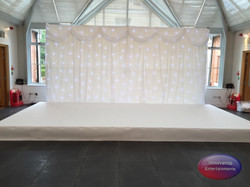 White stage and backdrop