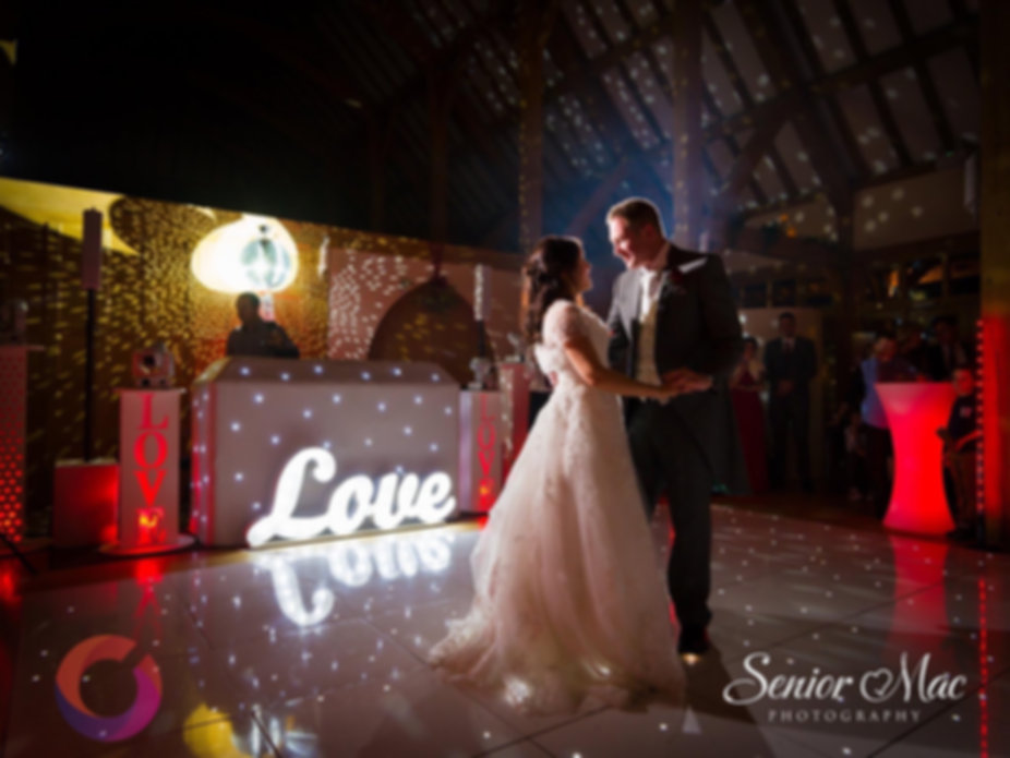 A first dance at a wedding with our White sparkle disco package