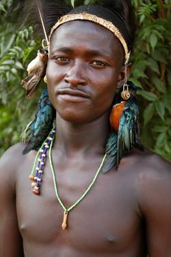 Samburu (24)_PATRICK WITH BIRD TROPHIES.jpg