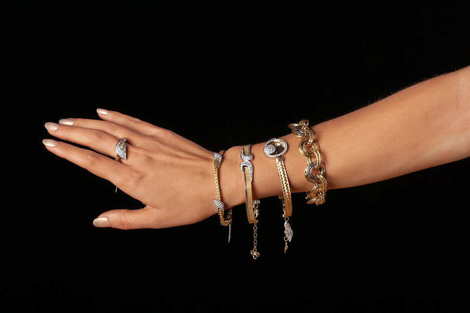 Female hand with jewelry, on black bacgr