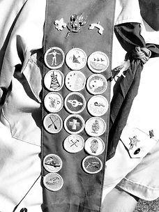 Merit badges hanging on a man