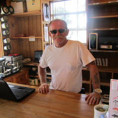 Jim Murray behind counter.jpg