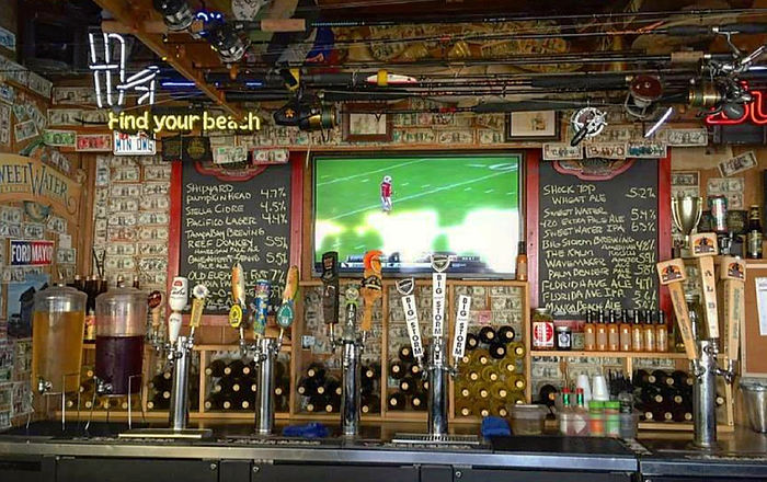 Bar with taps and football
