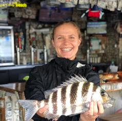 Kat with fish at BH.png