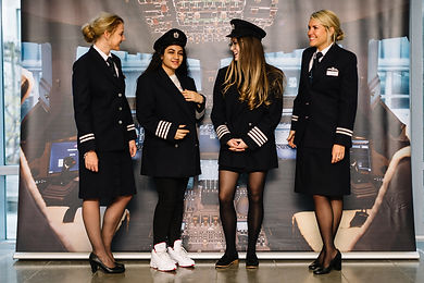 7 - Pro pic - girls trying on uniforms.j