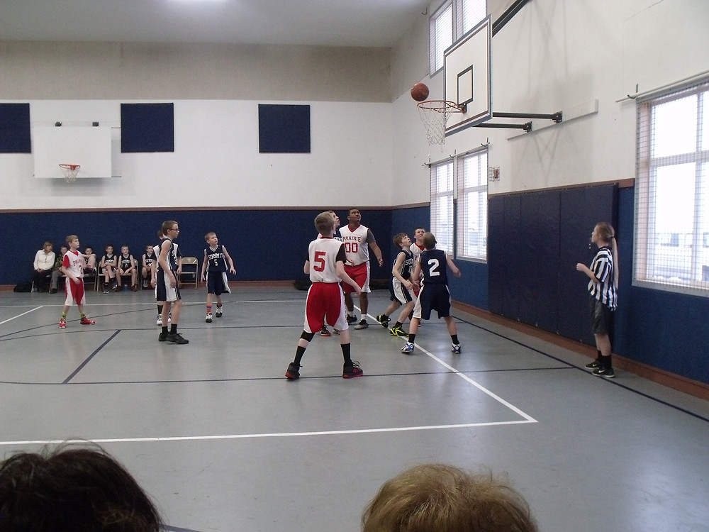 Summit and Prairie 5-6th players wait for the rebound in a recent game held at Summit Academy.