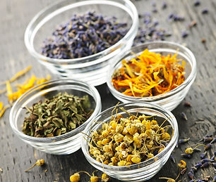 Assortment of dry medicinal herbs in gla