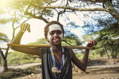 Maasai warrior with walking stick.