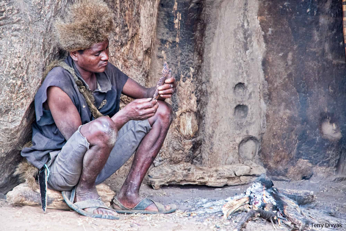 Hadzabe woodcarver making a pipe