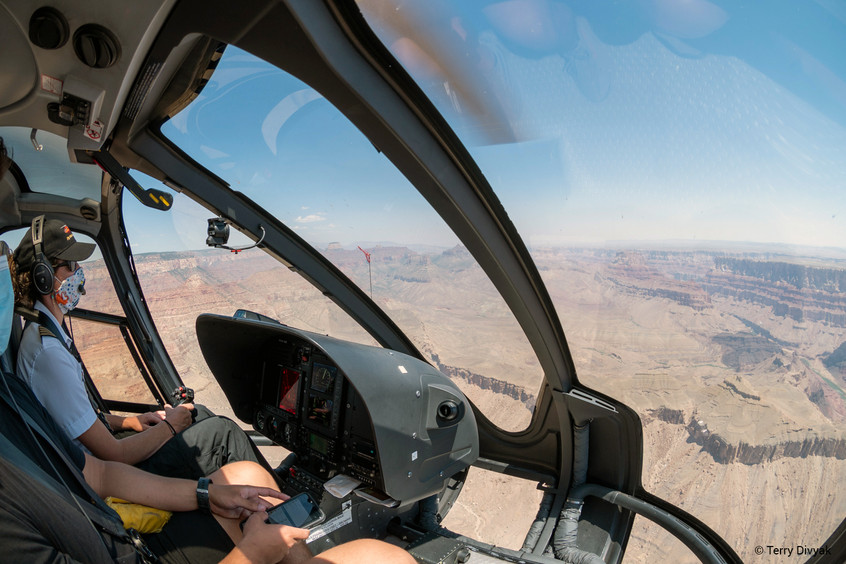 Helicopter Pilot Flying Over Grand Canyon
