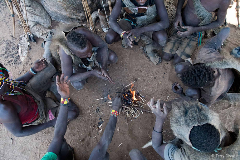 Campfire with Hadzabe men after a hunt
