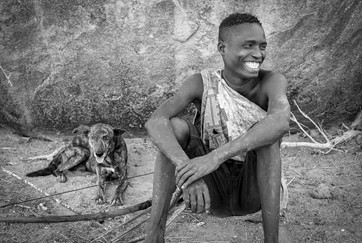 Hadzabe hunter and his dog near lake Eyasi in Tanzania