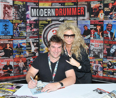Me signing an autograph at the Modern Drummer booth at NAMM where I had an image published.