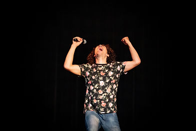 Sam Malcolm wows the crowd peforming Stand-up Comedy