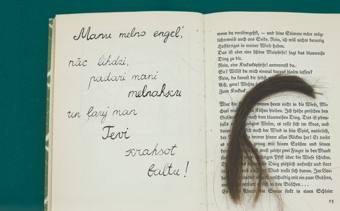 MANU MELNO ENGEL (MY BLACK ANGEL)  Poem inscribed in a book and an unidentified hair strand. (German period, circa 1918). Photo Ansis Starks.