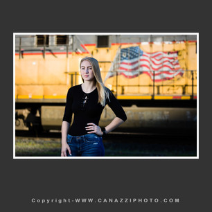 High School Senior Gal standing with yellow train in Portland Oregon_319.jpg