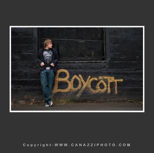High School Senior Guy near Boycott graffiti in Industrial Portland Oregon _305.jpg
