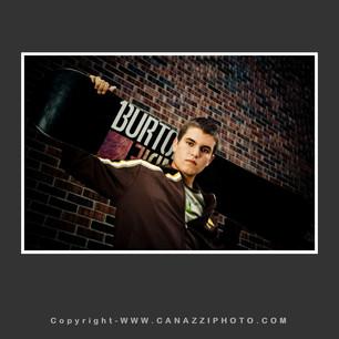 High School Senior Guy with skateboard against brick wall Industrial Vancouver Washington_237.jpg