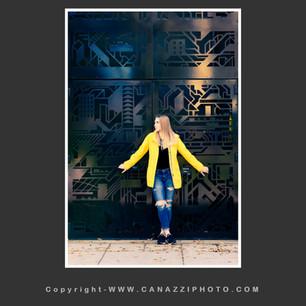 High School Senior Gal wearing yellow jacket in Urban Portland Oregon_313.jpg