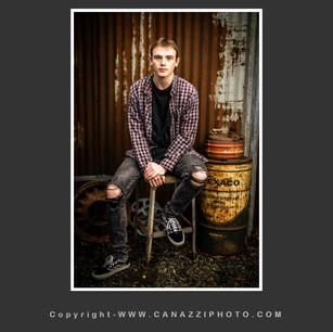 High School Senior Boy seated with rustic auto parts Vancouver Washington_139.jpg