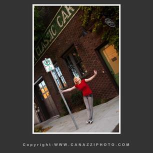 High School Senior Gal holding on to signpost in Urban Portland Oregon_330.jpg