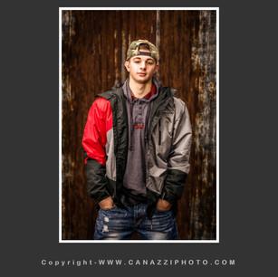 High School Senior Boy standing outside with jacket Vancouver Washington_120.jpg