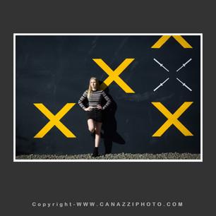High School Senior Gal against black wall with yellow crosses in Portland Oregon_322.jpg
