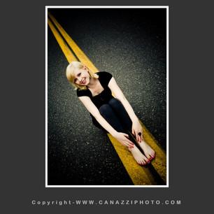 High School Senior Gal on road with yellow stripe Urban Vancouver Washington_201.jpg