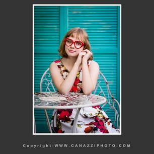 High School Senior Girl sitting outside with heart glasses Vancouver Washington_118.jpg