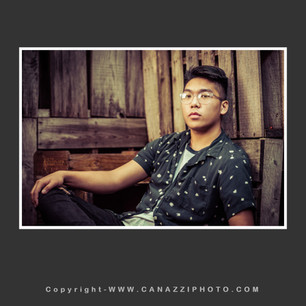 High School Senior Boy with glasses reclining on rustic pallets Vancouver Washington_148.jpg