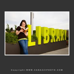 High School Senior Gal with Vancouver Library sign Washington.jpg