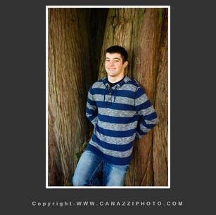 High School Senior Boy standing against large tree Vancouver Washington_126.jpg