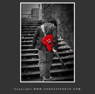 High School Senior Guy going up steps with red guitar taken in Urban Portland Oregon _308.jpg