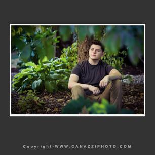 High School Senior Boy sitting under tree looking away Vancouver Washington_150.jpg