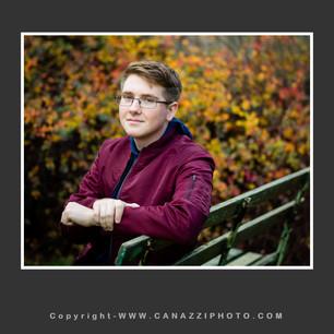 High School Senior Boy sitting on green bench with fall colors Vancouver Washington_149.jpg