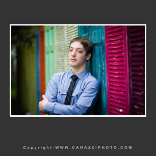 High School Senior Boy standing against multicolored doors Vancouver Washington_144.jpg