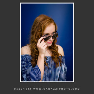 High School Senior Girl with sunglasses against blue backdrop Vancouver Washington_137.jpg