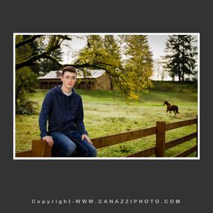 High School Senior Guy on fence with horse in pasture Ridgefield Washington_210.jpg