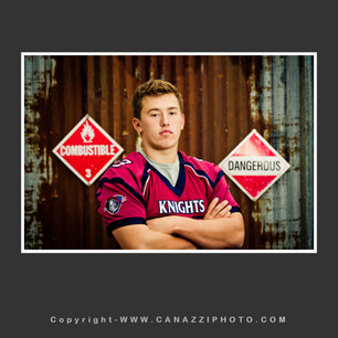 High School Senior Boy in football jersey standing with signs Vancouver Washington created at private outdoor studio_128.jpg
