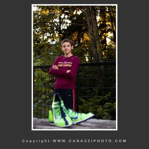 High School Senior Guy with green track shoes at WSU Vancouver Washington_219.jpg