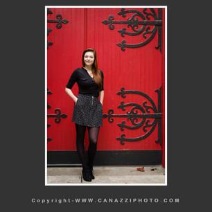 High School Senior Gal standing with big red door in Portland Oregon_318.jpg