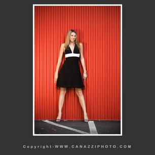 High School Senior Gal with black dress against red metal building in Urban Portland Oregon _306.jpg
