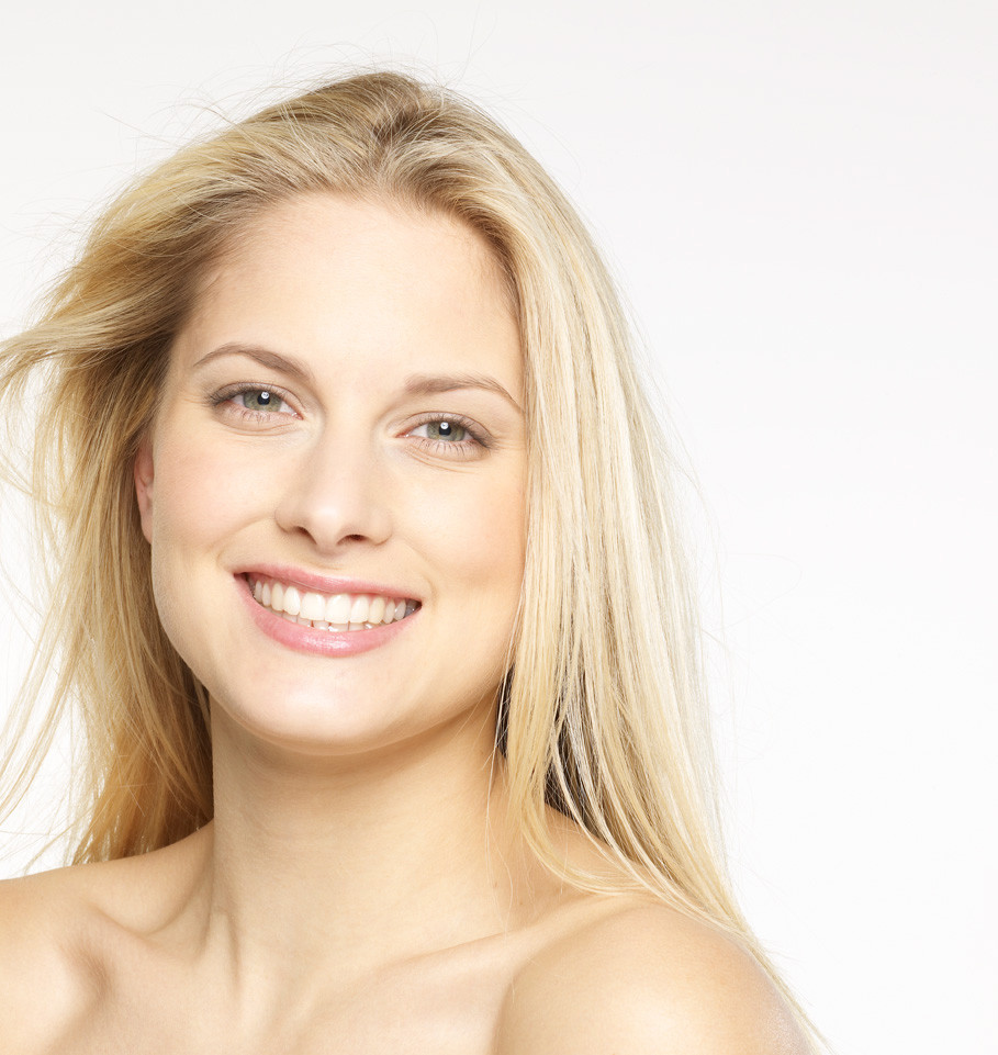 Blonde woman with straight teeth smiling