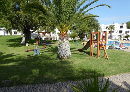 A children's play area close to a pool