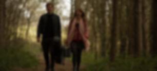 Morris & Watson walking through the woods.