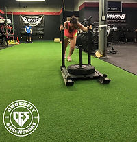 Kelly getting after some sled pushes dur