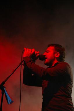O. Canatan singing at a gig.