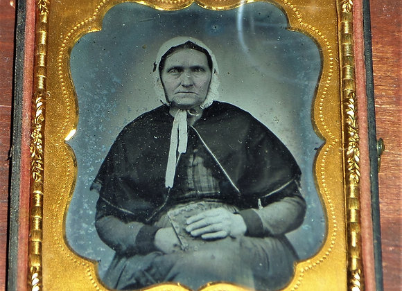 Ambrotype of Old Woman with Decorated Book in Her Hands