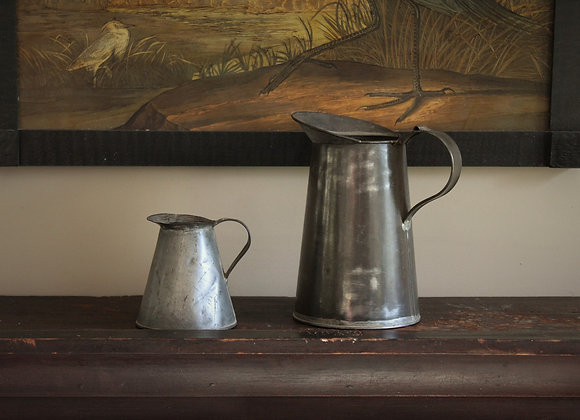 Set of Two Vintage Tin Pitchers